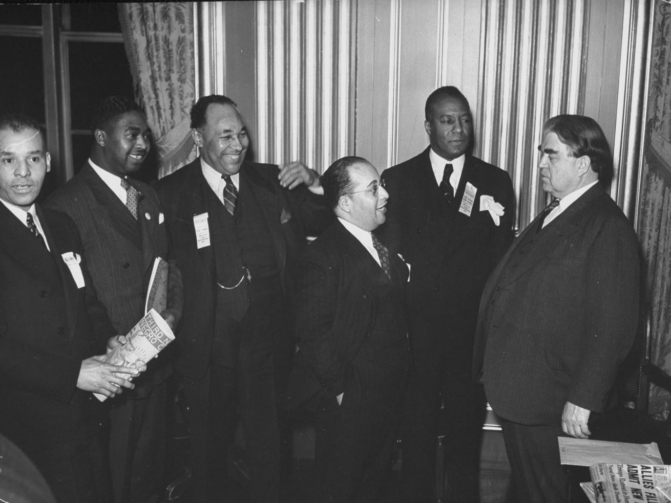 John L. Lewis (R), president of the Congress of Industrial Organizations, talking with other leaders at the National African American Congress, in January 1940.