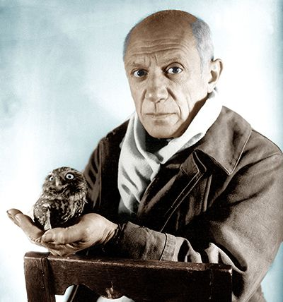 Picasso holding an owl.