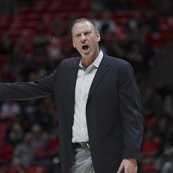 Utah Utes head coach Larry Krystkowiak yells at the ref in Salt Lake City on Thursday, Feb. 6, 2020. Utah won 64-56 in overtime.