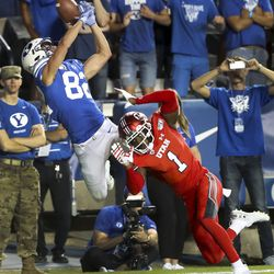BYU wide receiver Dax Milne (82) is unable to make a catch in the end zone because Utah quarterback Jason Johnson (1) applies defensive pressure during Utah-BYU football game at LaVell Edwards Stadium in Provo on Thursday, August 29, 2019.