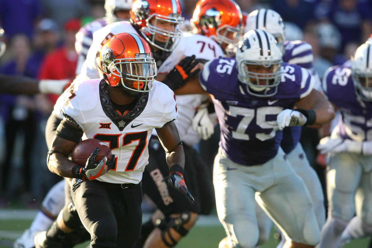MANHATTAN, KS - Kansas State Wildcats defensive end Jordan Willis (75) draws a holding penalty while pursuing Oklahoma State Cowboys running back Justice Hill (27) at Bill Snyder Family Football Stadium.
