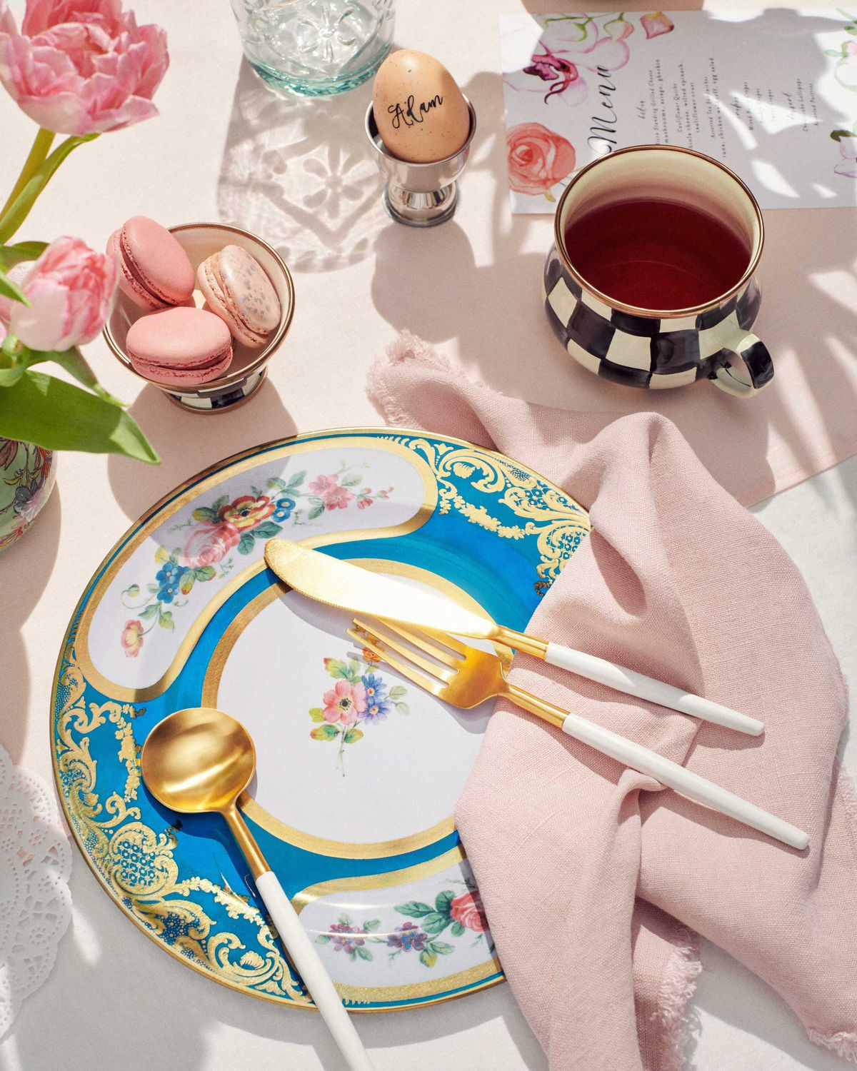 Colorful plate with gold and white flatware.