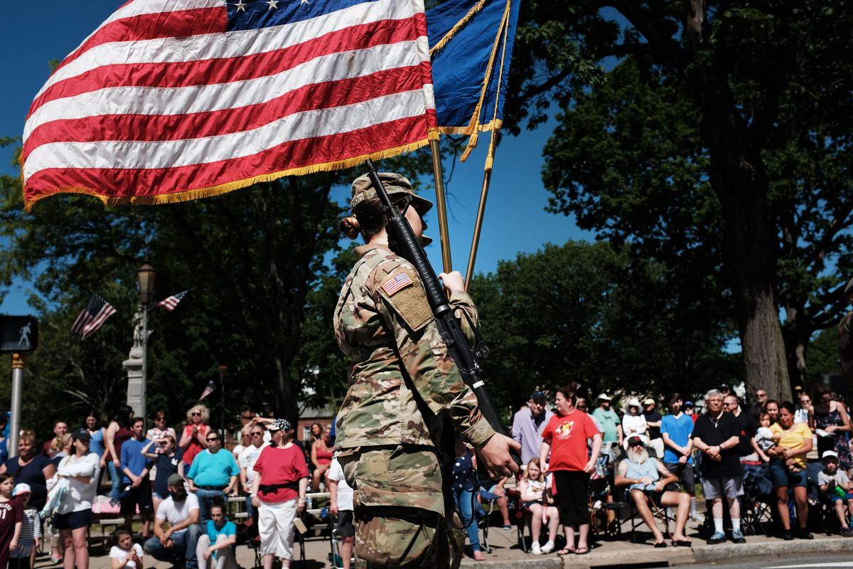 People watch as parade participants march through town during the annual Memorial Day Parade on May 27, 2019 in Naugatuck, Connecticut.