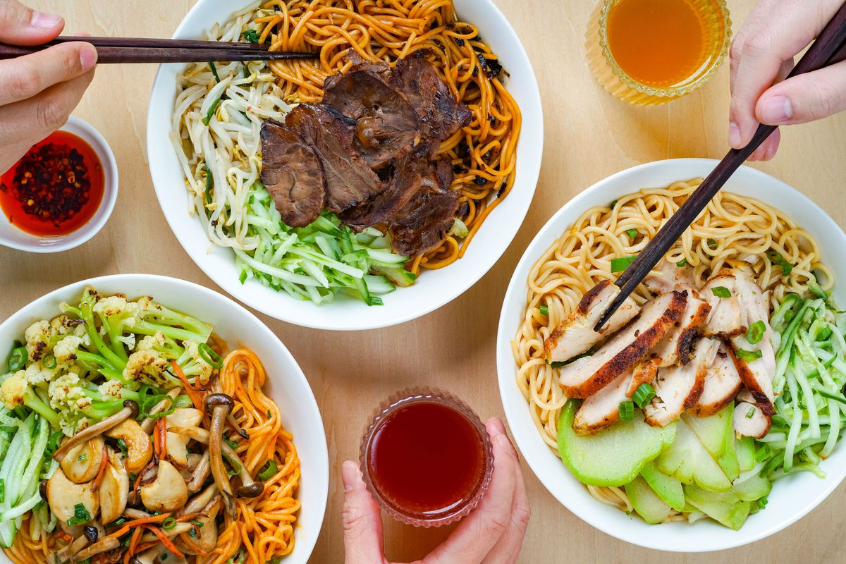 Three noodle bowls topped with various proteins