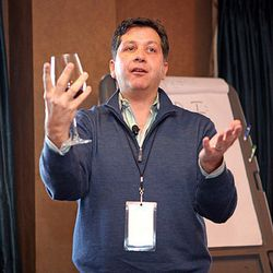 """The Food & Wine wise guy Anthony Giglio preaches about how you should never hold a wine glass. In this pose he demonstrates """"The Hail Mary Passhold,"""" a wine snob no-no."""