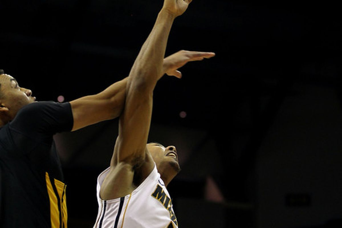 COLUMBIA, MO - DECEMBER 15:  Phil Pressey #1 of the Missouri Tigers is fouled during the game against the Kennesaw State Owls on December 15, 2011 at Mizzou Arena in Columbia, Missouri.  (Photo by Jamie Squire/Getty Images)