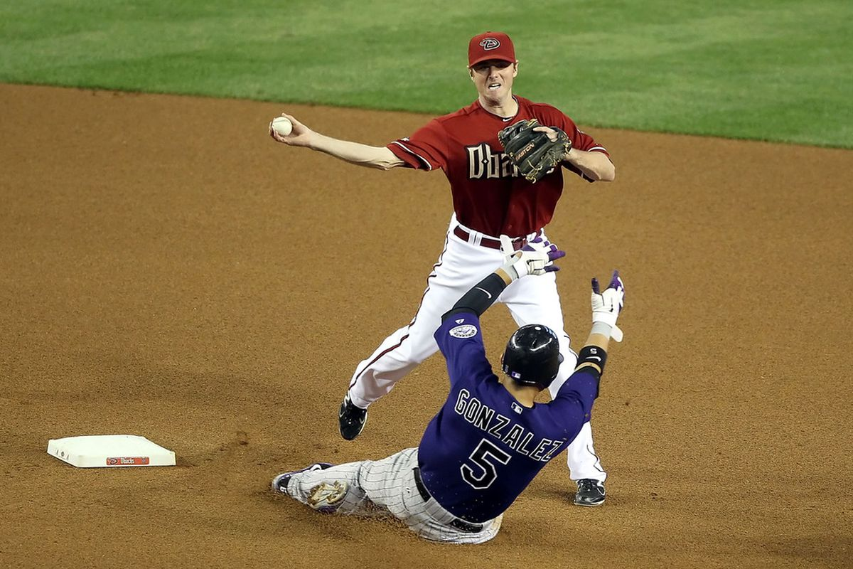 Wilson throws over CarGon to complete a double play at Chase Field on May 4, 2011