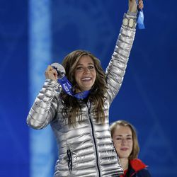 Women's skeleton silver medalist Noelle Pikus-Pace of the United States smiles during the medals ceremony at the 2014 Winter Olympics, Saturday, Feb. 15, 2014, in Sochi, Russia.