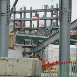 Workers along the right field wall and on the left field jumbotron structure -