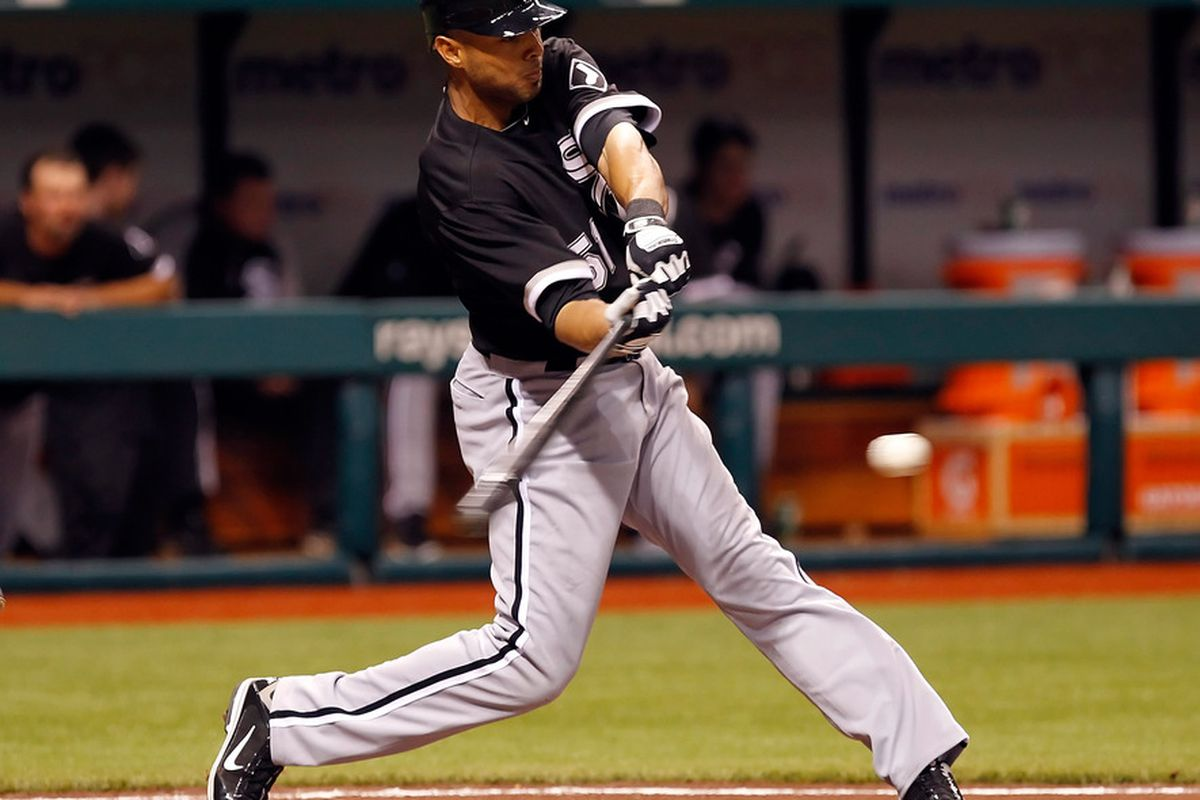 ST. PETERSBURG, FL - APRIL 18:  Outfielder Alex Rios #51 of the Chicago White Sox fouls off a pitch against the Tampa Bay Rays during the game at Tropicana Field on April 18, 2011 in St. Petersburg, Florida.  (Photo by J. Meric/Getty Images)