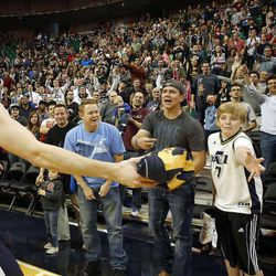 Gordon Hayward gives a signed jersey to a fan following Utah Jazz scrimmage in Salt Lake City, Saturday, Oct. 5, 2013.