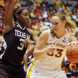 Iowa State's Chelsea Poppens drives as Texas A&M's Kelsey Bone tries to block during 2nd haf at Hilton Coliseum Saturday, Jan 14, 2012, in Ames, Iowa.