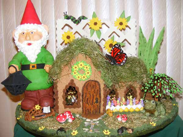 Gingerbread bread house with a roof covered in rosemary.