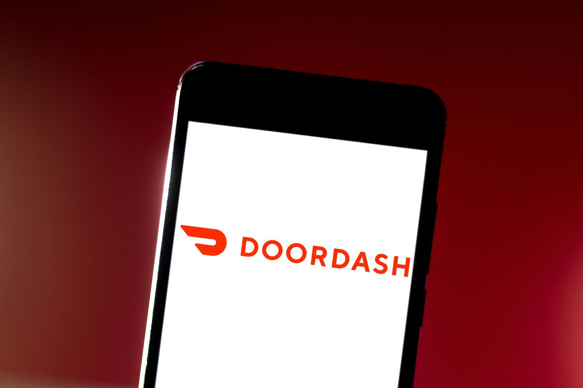 In this photo illustration the DoorDash logo is seen on a mobile phone