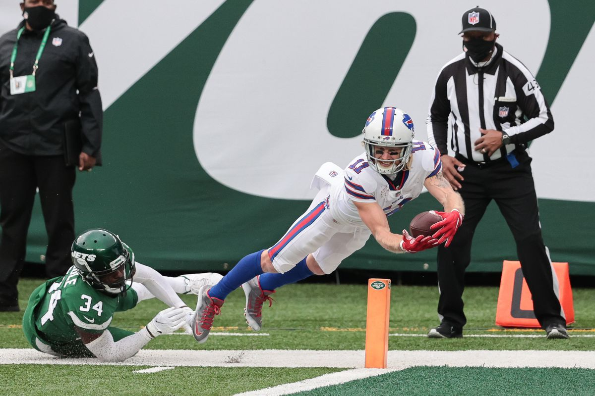Buffalo Bills wide receiver Cole Beasley (11) catches the ball in front of New York Jets cornerback Brian Poole (34) during the second half at MetLife Stadium.