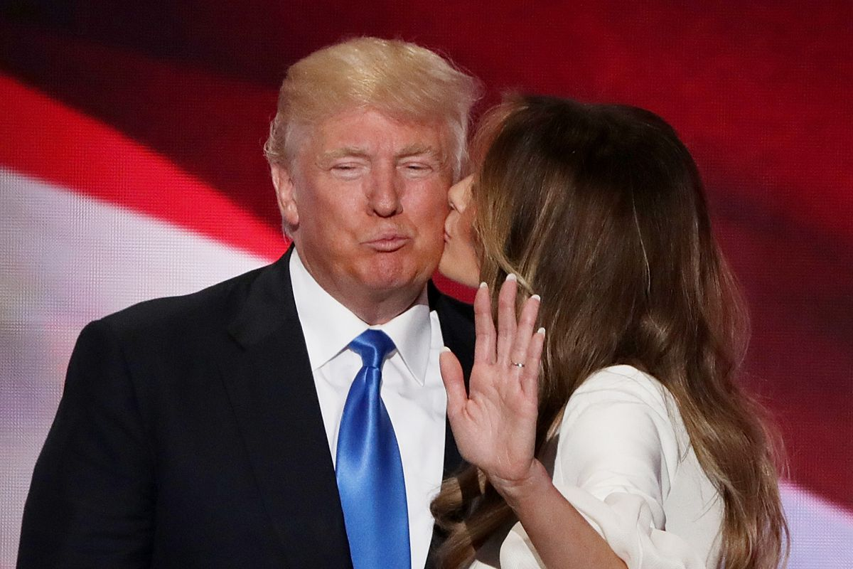 Melania Trump kissing Donald Trump.