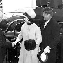"""Jackie wearing a Oleg Cassini and a matching pillbox hat by Halston at Inauguration in 1961, via <a href=""""http://www.stylelist.com/view/inauguration-style-throughout-years-its-all-about-first-ladys-coat"""">Styleist</a>"""