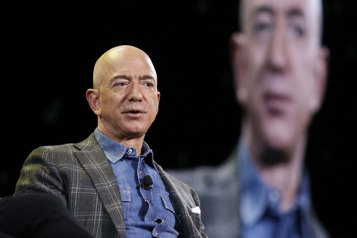 In this June 6, 2019, file photo Amazon CEO Jeff Bezos speaks at the the Amazon re:MARS convention in Las Vegas. Bezos' total wealth number jumped to $138 billion Monday on the Bloomberg Billionaires Index.