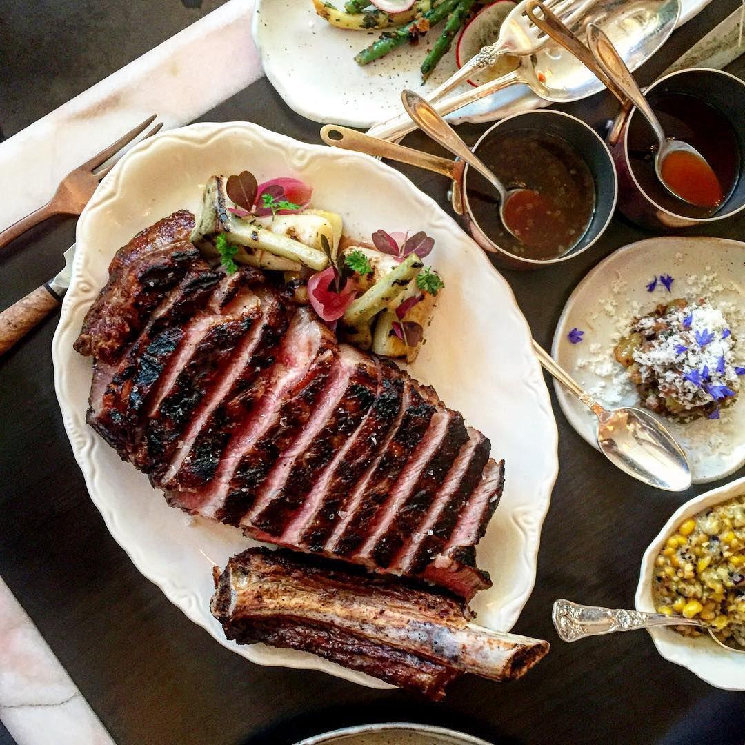 A medium-rare steak sliced on a plate.