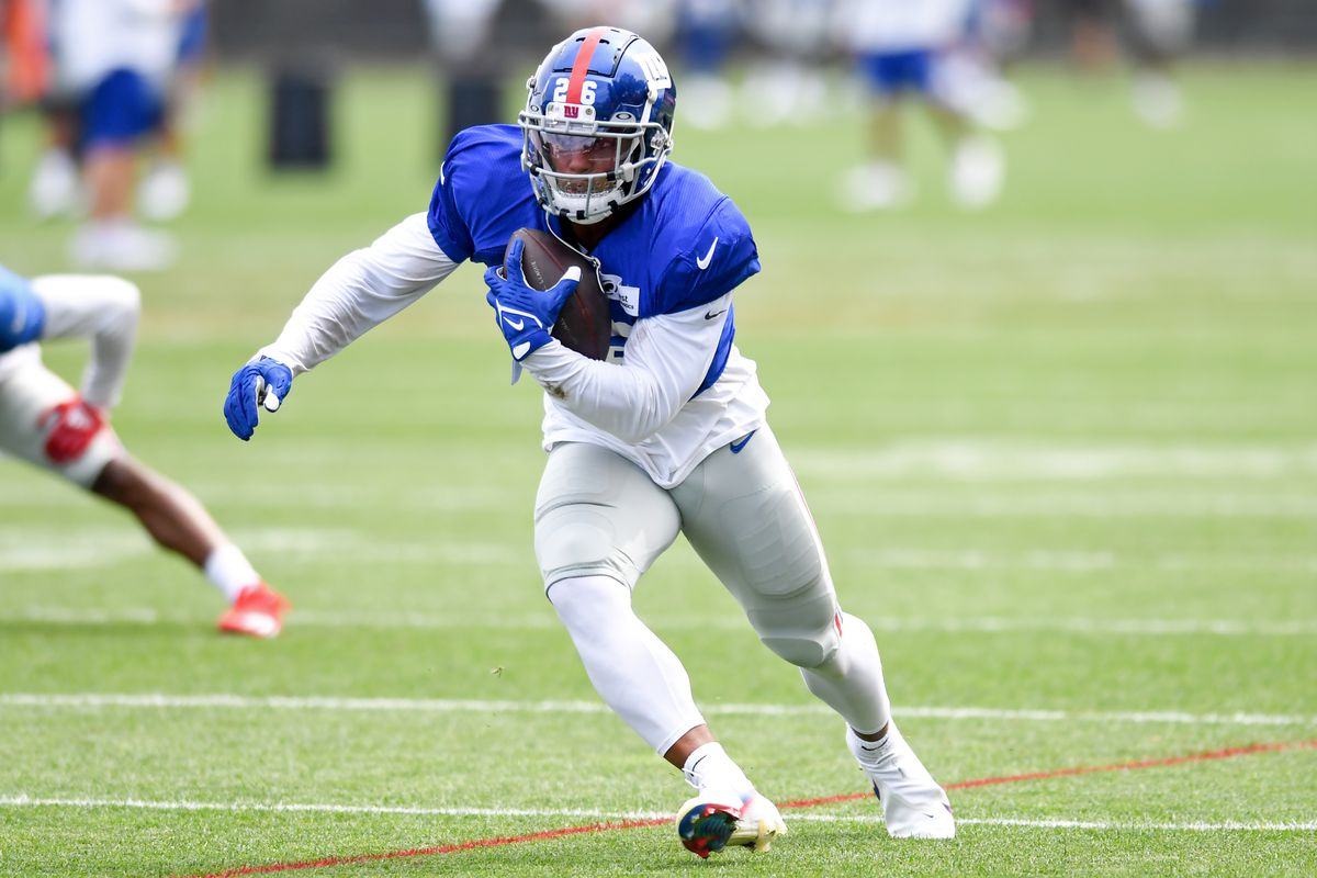Running back Saquon Barkley #26 of the New York Giants runs a drill during a joint practice with the Cleveland Browns on August 19, 2021 in Berea, Ohio.