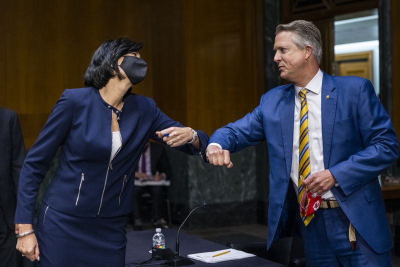 Dr. Rochelle Walensky, left, director of the U.S. Centers for Disease Control and Prevention, greets Sen. Roger Marshall, R-Kansas, right, on Tuesday.