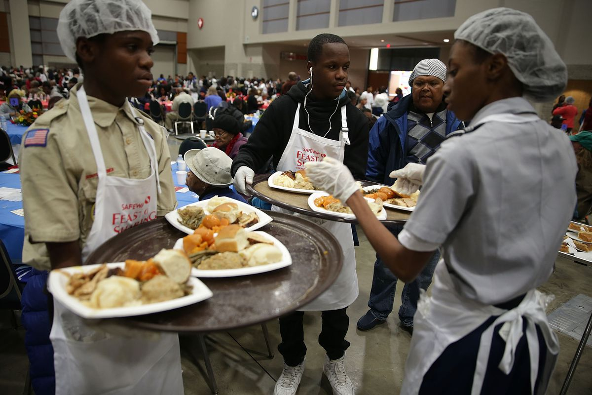 Volunteers Serve Thanksgiving Meal To Thousands At Washington Convention Center