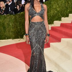 Naomi Campbell wears a Roberto Cavalli gown and Verdura jewels.