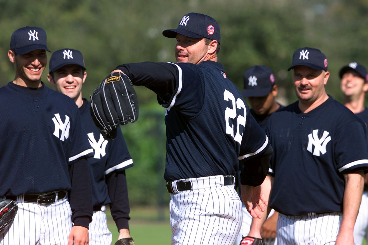 New York Yankees' pitcher Roger Clemens throws a fake pitch