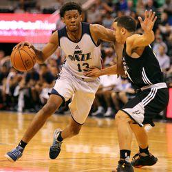 Utah Jazz's Tyrone Wallace moves around San Antonio Spurs' Angel Rodriguez during Utah Jazz Summer League at the Vivant Smart Home Arena in Salt Lake City on Monday, July 4, 2016. San Antonio won 90-69.
