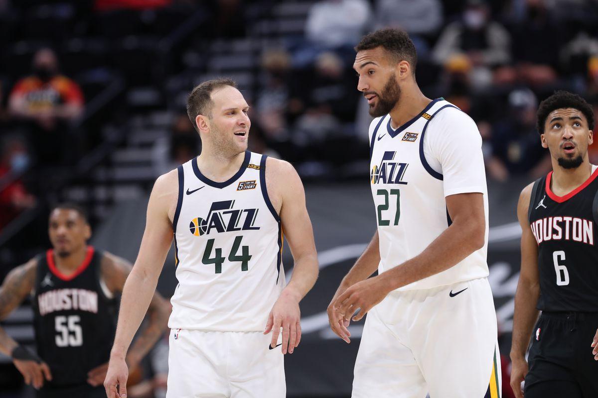 Bojan Bogdanovic of the Utah Jazz talks to teammate Rudy Gobert during the game against the Houston Rockets on May 8, 2021 at vivint.SmartHome Arena in Salt Lake City, Utah.
