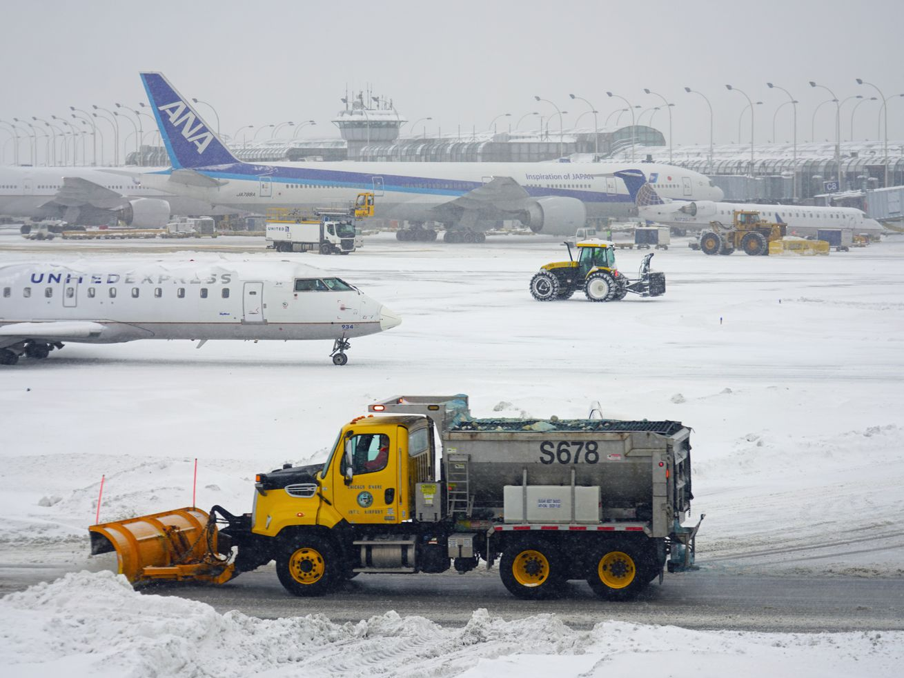 Planes during a winter snow storm at the Chicago O'Hare International Airport.