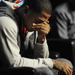 Chicago Bulls' Derrick Rose breaks down and cries during a news conference unveiling his new shoe the Adidas D Rose 3 in Chicago, Thursday, Sept. 13, 2012.