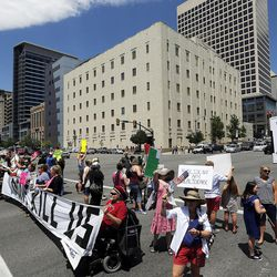 Protesters opposed to a Senate GOP health care bill stand in the middle of State Street during a protest in Salt Lake City on Tuesday, June 27, 2017.