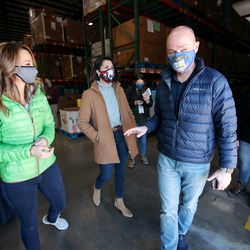 Abby Cox, left, and her husband, Gov.-elect Spencer Cox, right, talk with Lt. Gov.-elect Deidre Henderson, center, as they walk out of theUtah Food Bank in St. George to speak to members of the media on Saturday, Jan. 2, 2021. The Coxes, along with Lt. Gov.-elect Deidre Henderson and members of their families, volunteered at the food bank.