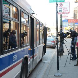 3:14 p.m. A CTA bus pulled up on Addison Street, blocking the view of two television news camera crews, just as the third segment of the marquee was being removed -