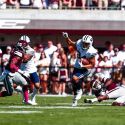 BYU wide receiver Neil Pau'u, center, runs with the ball after a catch as a pair of Mississippi State players try to make the stop during the first half at Davis Wade Stadium in Starkville, Miss., on Saturday, Oct. 14, 2017.