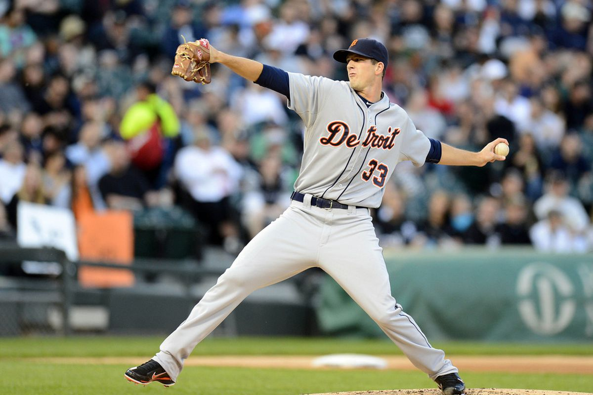Detroit Tigers starting pitcher Drew Smyly (33) makes a throw against the Chicago White Sox in the first inning at US Cellular Field.  Mandatory Credit: Mike DiNovo-US PRESSWIRE