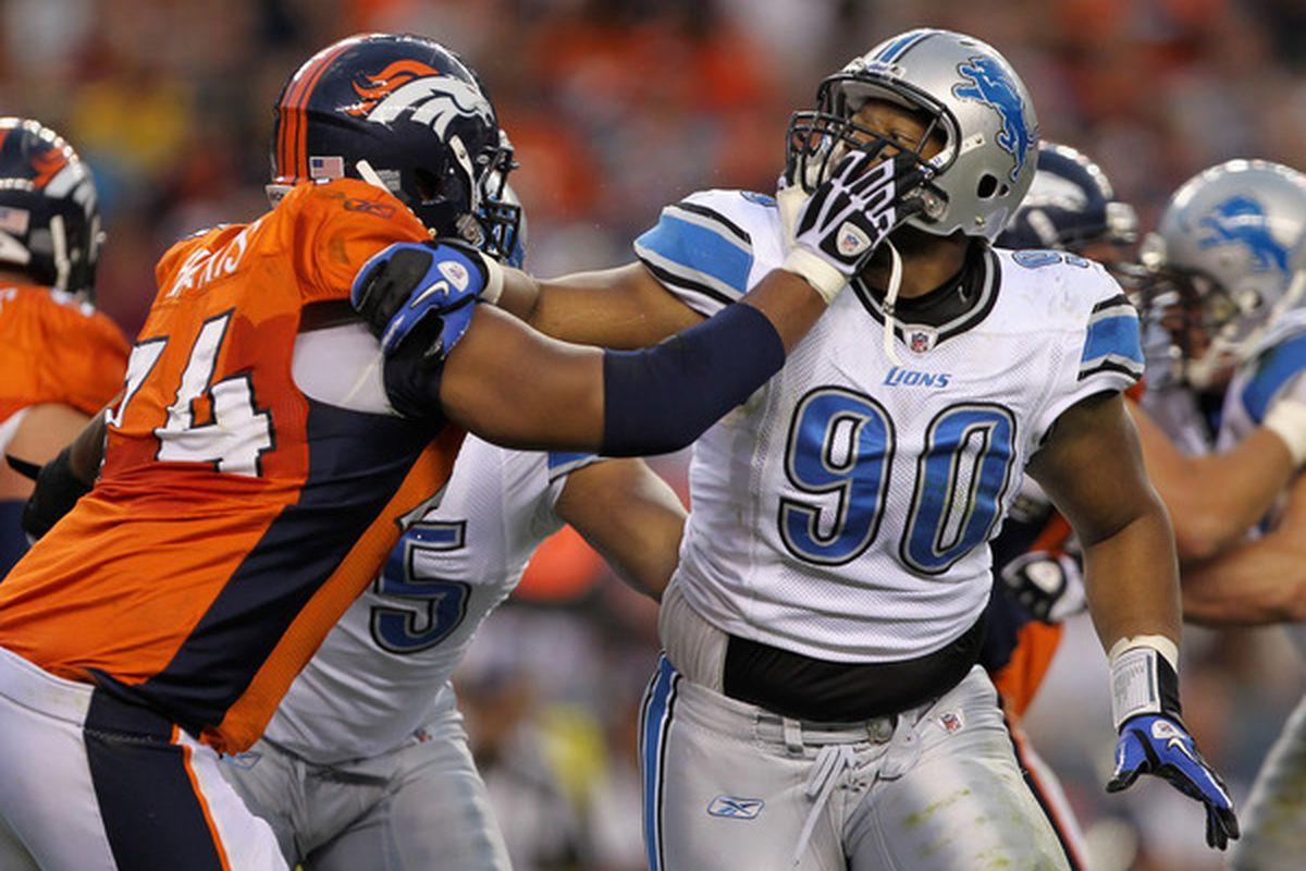 Ndamukong Suh of the Detroit Lions battles the blocking of offensive tackle Ryan Harris of the Denver Broncos.  (Photo by Doug Pensinger/Getty Images)