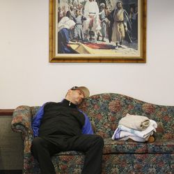 Charles Mathieu sleeps in an LDS Church stake center during Tropical Storm Harvey in Houston on Tuesday, Aug. 29, 2017.