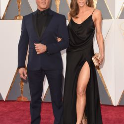 Best Supporting Actor nominee Sylvester Stallone and Jennifer Flavin. Another leg slit! Photo: Jason Merritt/Getty Images