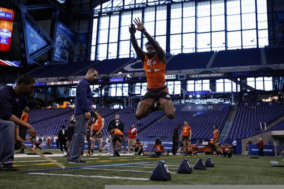 Feb 26, 2012; Indianapolis, IN, USA; Baylor Bears quarterback Robert Griffin III does the broad jump during the NFL Combine at Lucas Oil Stadium. Mandatory Credit: Brian Spurlock-US PRESSWIRE
