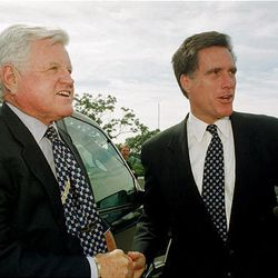 Sen. Edward Kennedy, D-Mass., and Mitt Romney greet each other before taking a tour of the newly completed LDS temple in Belmont, Mass., on Sept. 8, 2000. Romney, a Mormon who gave Kennedy a tough challenge for his Senate seat in 1994, invited Kennedy to participate in the tour.