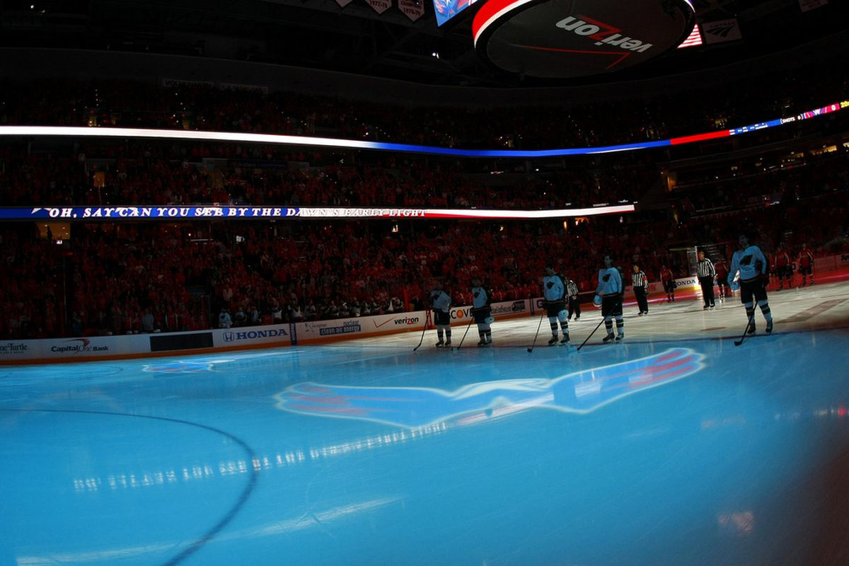 March 25, 2012; Washington, DC, USA; Minnesota Wild and Washington Capitals players  on the ice during the national anthem prior to their game at Verizon Center. The Capitals won 3-0. Mandatory Credit: Geoff Burke-US PRESSWIRE