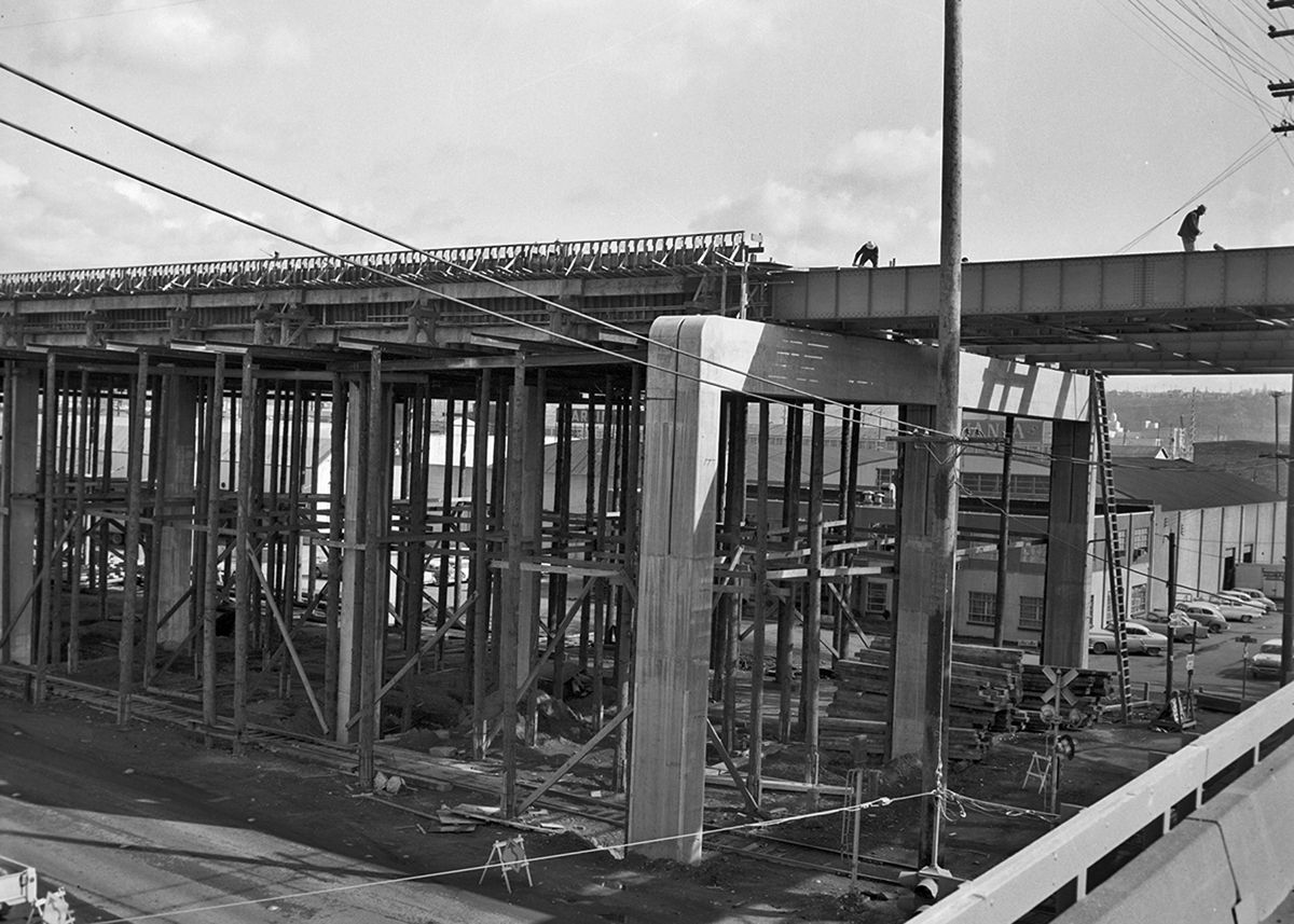 A construction site for the Alaskan Way viaduct. This is an old black and white photograph.