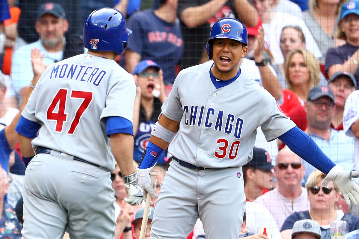 BOSTON, MA - APRIL 29: Jon Jay #30 of the Chicago Cubs congratulates Miguel Montero #47 after he scored a run against the Boston Red Sox during the seventh inning at Fenway Park on April 29, 2017 in Boston, Massachusetts. (Photo by Maddie Meyer/Getty Images)