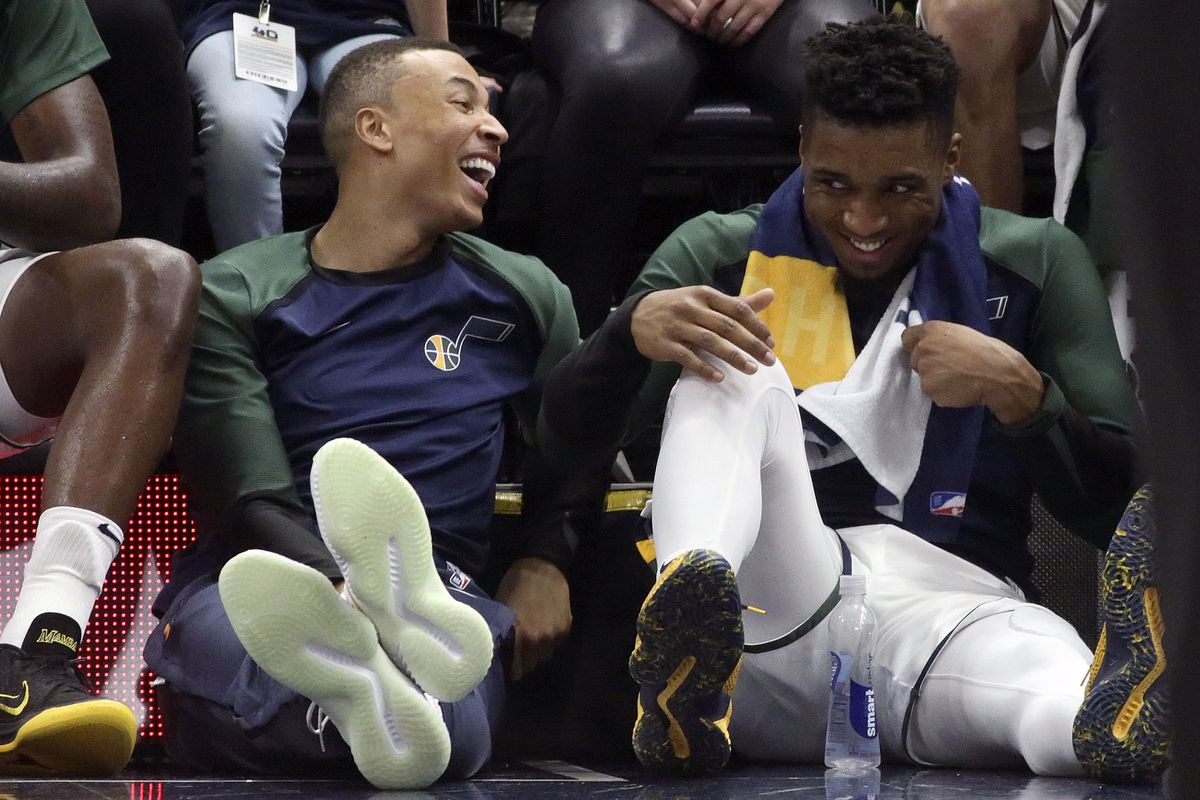The Utah Jazz's Dante Exum and Donovan Mitchell laugh while sitting on the floor watching the last few minutes of a preseason basketball game against the Adelaide 36ers at the Vivint Smart Home Arena in Salt Lake City on Friday, Oct. 5, 2018. The Jazz won