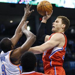 Los Angeles Clippers forward Blake Griffin, right, shoots as Oklahoma City Thunder forward Serge Ibaka (9) defends in the first quarter of an NBA baskerball game in Oklahoma City, Wednesday, April 11, 2012.
