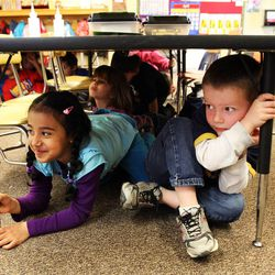 Jenifer Perdomo Mejia, left, and Stratton Rogers, students in Danielle Wilson's kindergarten class, participate in an earthquake drill at Vista Elementary in Taylorsville, Tuesday, April 17, 2012. This was part of the Great Utah ShakeOut.
