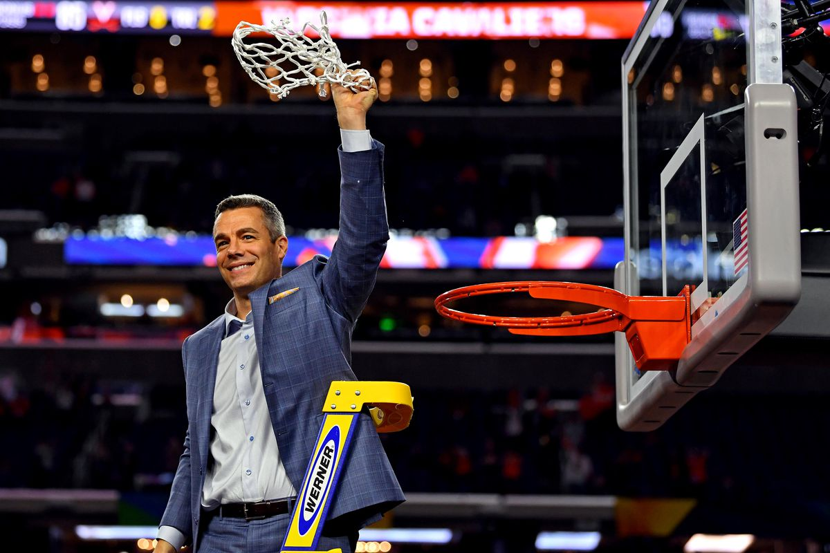 Virginia Cavaliers head coach Tony Bennett cuts down the net after beating the Texas Tech Red Raiders in the championship game of the 2019 men's Final Four at US Bank Stadium.