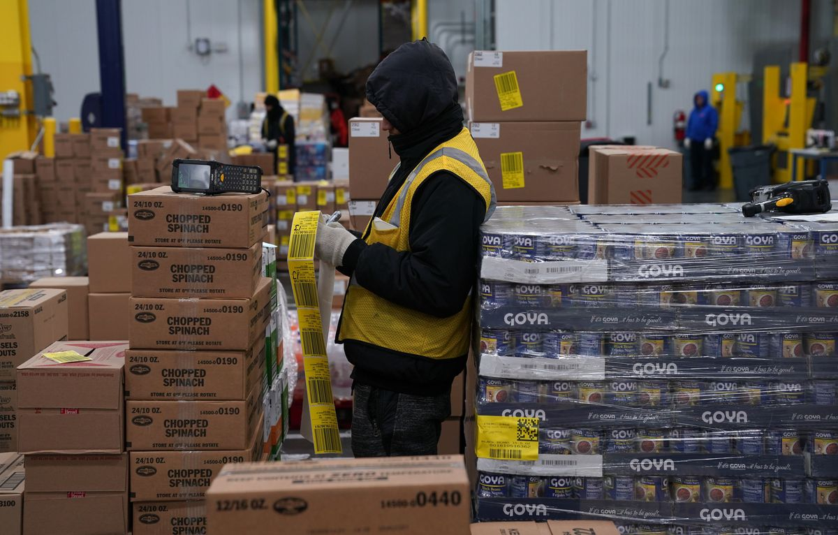 An employee sorting packing tape at the Fresh Direct Headquarters in the Bronx section of New York City